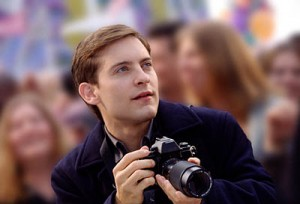 PeterParker-press-photographer-with-camera