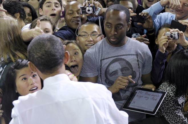 Obama-sign-iPad-Sylvester-CannIV-photo-Susan-Walsh-AP101021121492-660x437