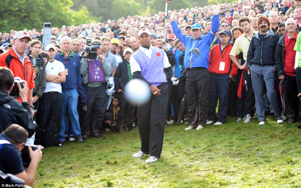 Tiger-Woods-hit-golf-ball-and-photographer-Mark-Pain