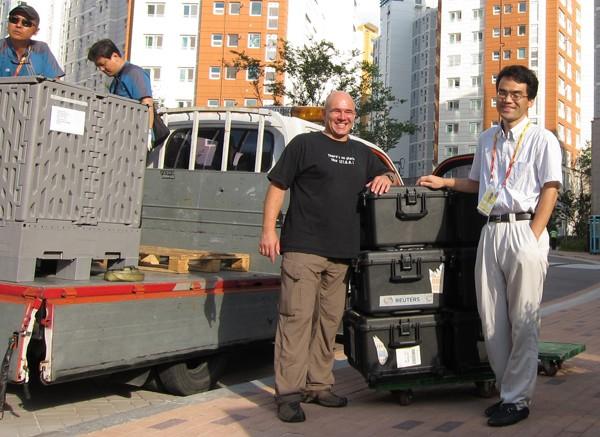 Peter Jebautzke Kiwhan Kim unloading equipment shipment before the start of the IAAF World Athletics Championships in Daegu