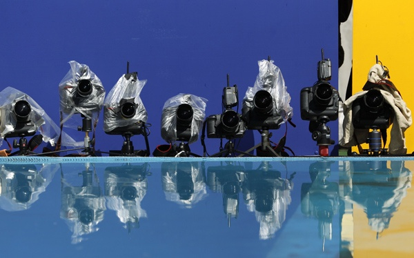 Remote cameras are reflected in the water jump at the IAAF World Championships in Daegu
