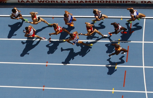 Competitors run during the men's 3,000 metres steeplechase heat at the IAAF World Championships in Daegu