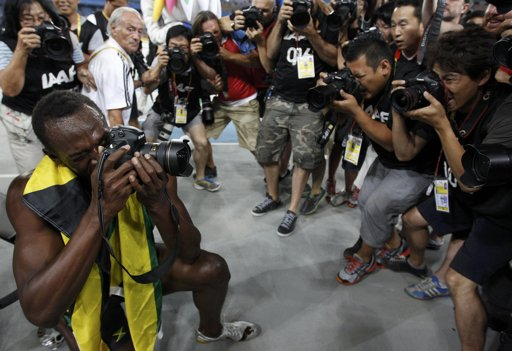 UsainBolt-camera-photoPhilNobleReuters