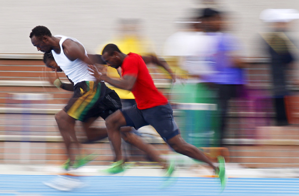 Bolt of Jamaica runs with his teammates during a training session for the IAAF World Championship in Daegu
