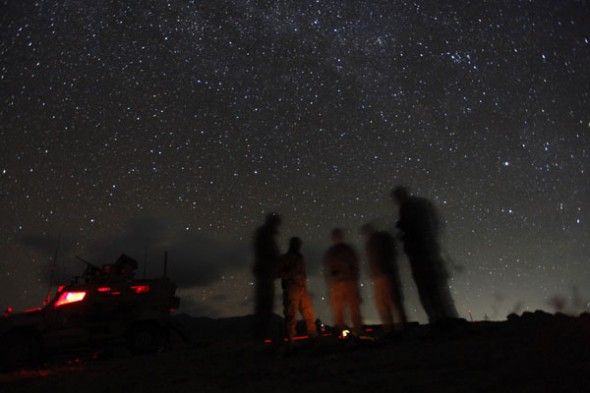 U.S. soldiers of 2nd Platoon C Company 9th Engineer Battalion COP Dash Towp stand around a fire during an overall security and distruption insurgency mission in Wardak province