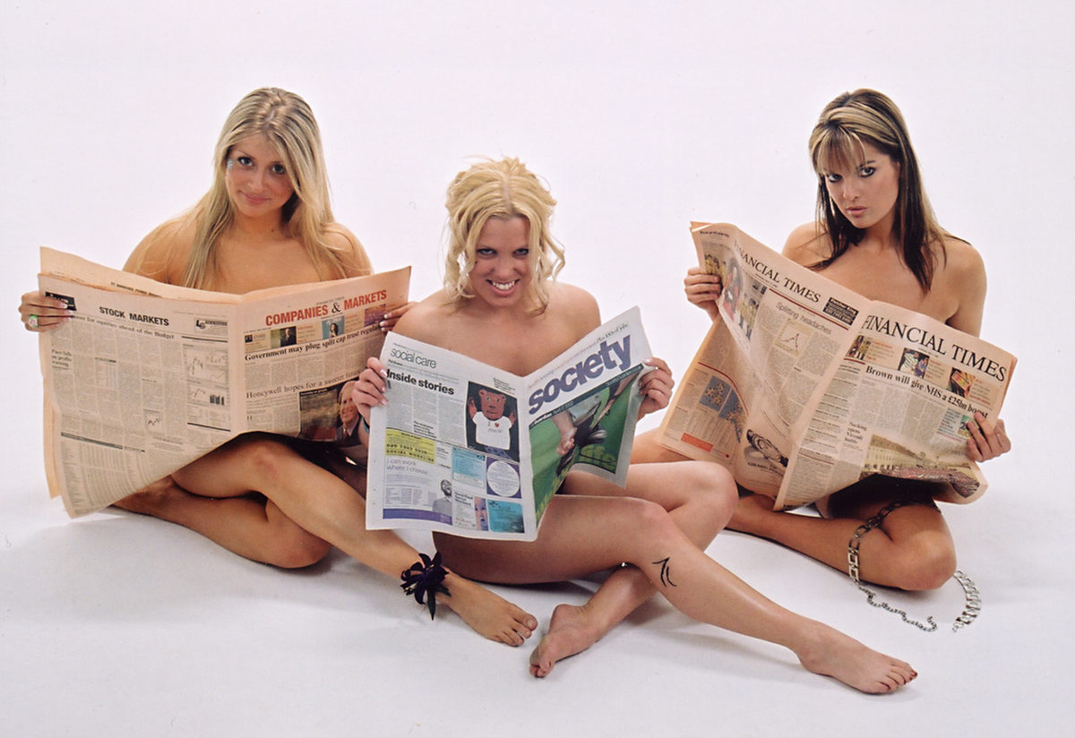 Girls with newspaper photo by Christopher Hawkins