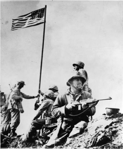 IwoJima-first-flag-raised-photoLouisRroweryLeatherneck