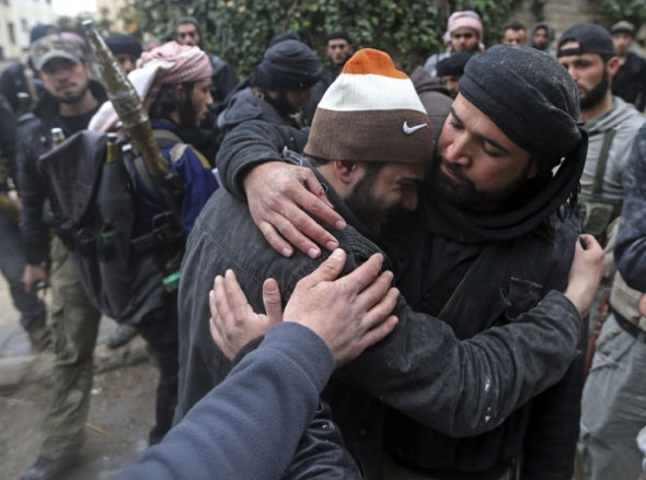 A wounded Free Syrian Army fighter cries after hearing that his friend died in a mission in the Ain Tarma neighbourhood of Damascus