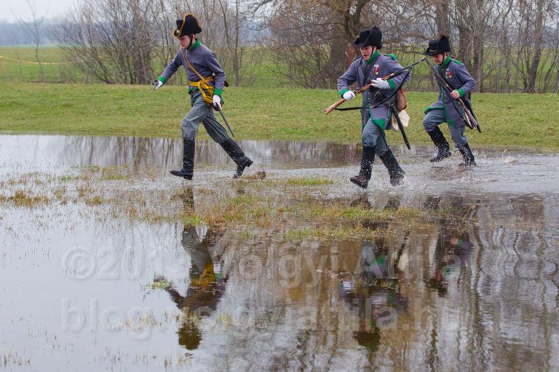 Tyrolean hunters cross a pond