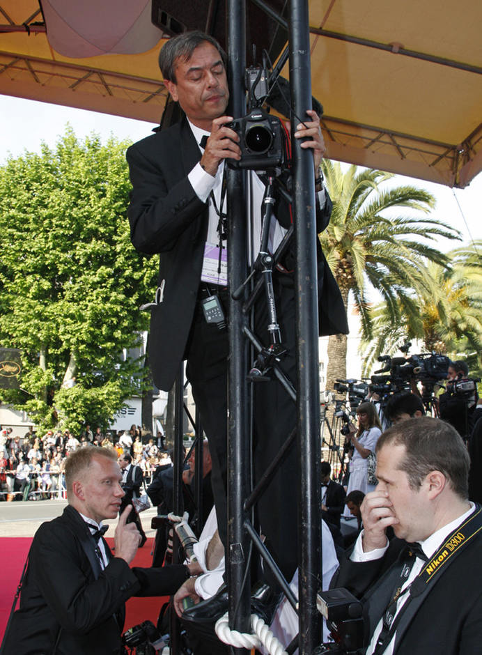 Photographers set up their cameras on the red carpet during the 62nd Cannes Film Festival May 14, 2009. Photo by Jean-Paul Pelissier/Reuters