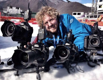 Getty Images' Lars Baron is a specialist in Ski Jumping and Biathlon. Here we see his rig with two Canon and Nikon bodies. The action happens too fast for photographers to switch lenses so every necessary focal length is ready to go with its own body. Photo by Getty Images