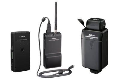 Fényképezőgép gyártók vezetéknélküli fájlküldő eszközeiCanon WFT-7 (B), Nikon WT-4 (K) és Nikon UT-1re szerelt WT-5 (J)Montázs (méretarány nem teljesen pontos)